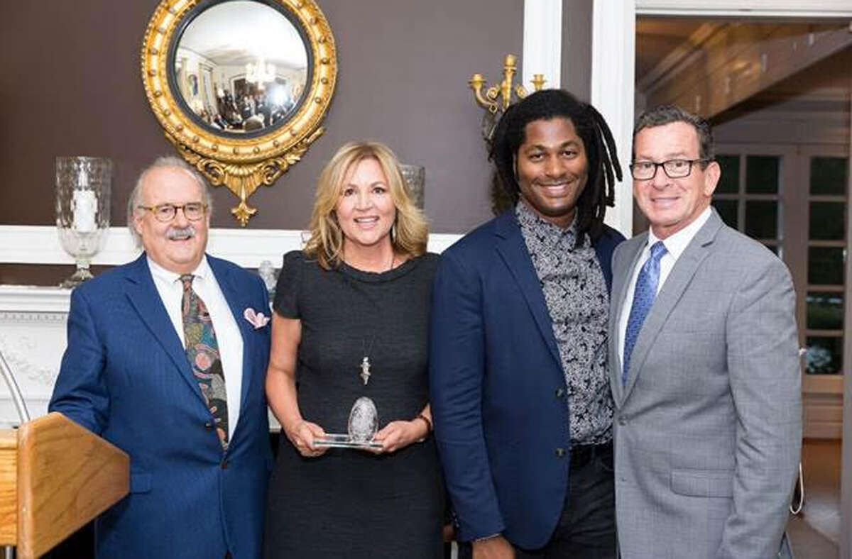 New Canaan: Grace Farms has received the Governor's Award. From left, Fritz Jellinghaus, chair of the Connecticut Arts Council; Sharon Prince, chair and president of Grace Farms Foundation; Kenyon Adams, Arts Initiative director of Grace Farms Foundation; Gov. Dannel P. Malloy at the Governor's residence in Hartford on Sept. 27. - Contributed photo by Nick Cinea Photography