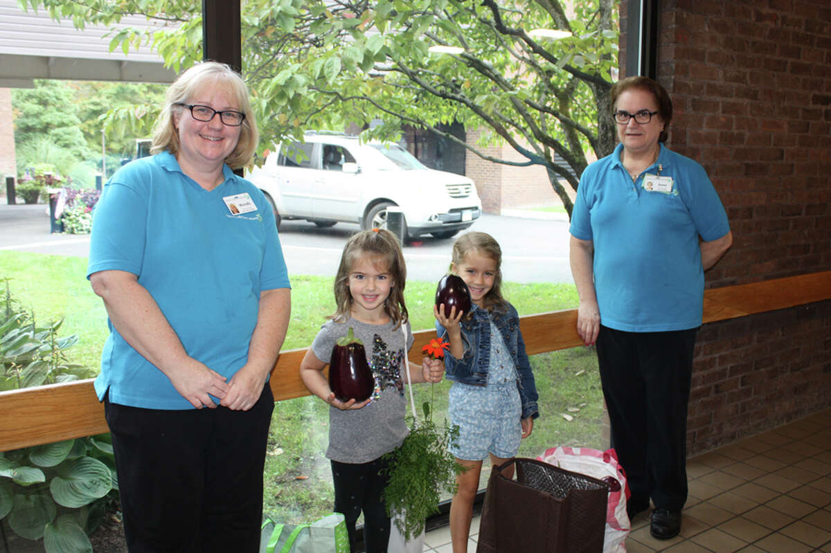 New Canaan: Kindergarteners from South School deliver vegetables and flowers from the school's garden to Waveny LifeCare Network. - Contributed photo