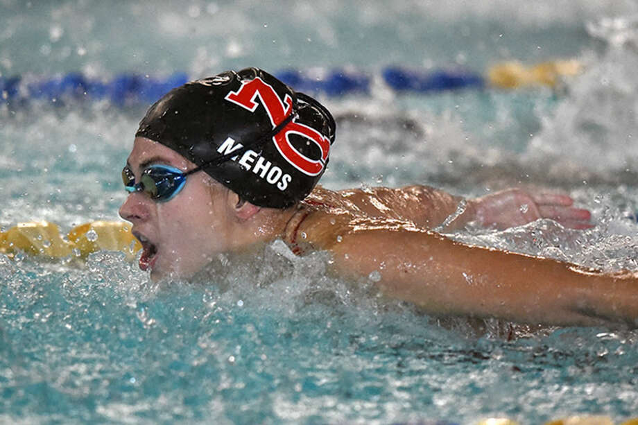 New Canaan junior Alex Mehos competes in the 100 butterfly during Wednesday's swim meet at the Darien YMCA. — Dave Stewart photo