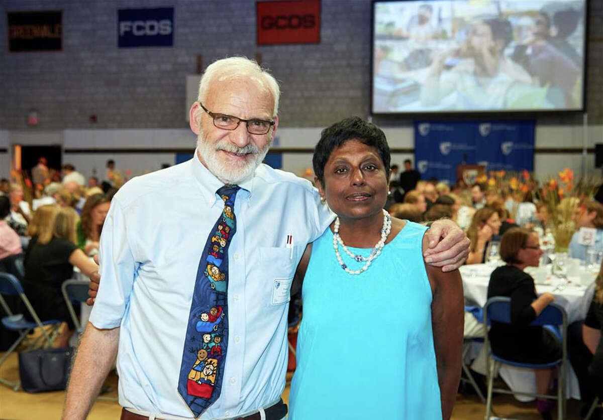 New Canaan Country School sixth grade teacher Fraser Randolph of Danbury and Kindergarten teacher Lilani Balasuriya of Stamford were each recognized for their 30 years of extraordinary teaching at the school's annual meeting. - Contributed photo