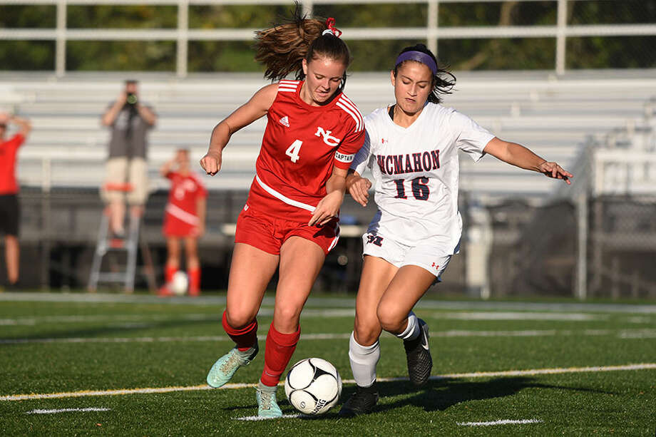 New Canaan senior co-captain Kendall Patten battles McMahon's Kailynn Ortiz in the midfield during Friday's girls soccer game at Dunning Field. — Dave Stewart photo