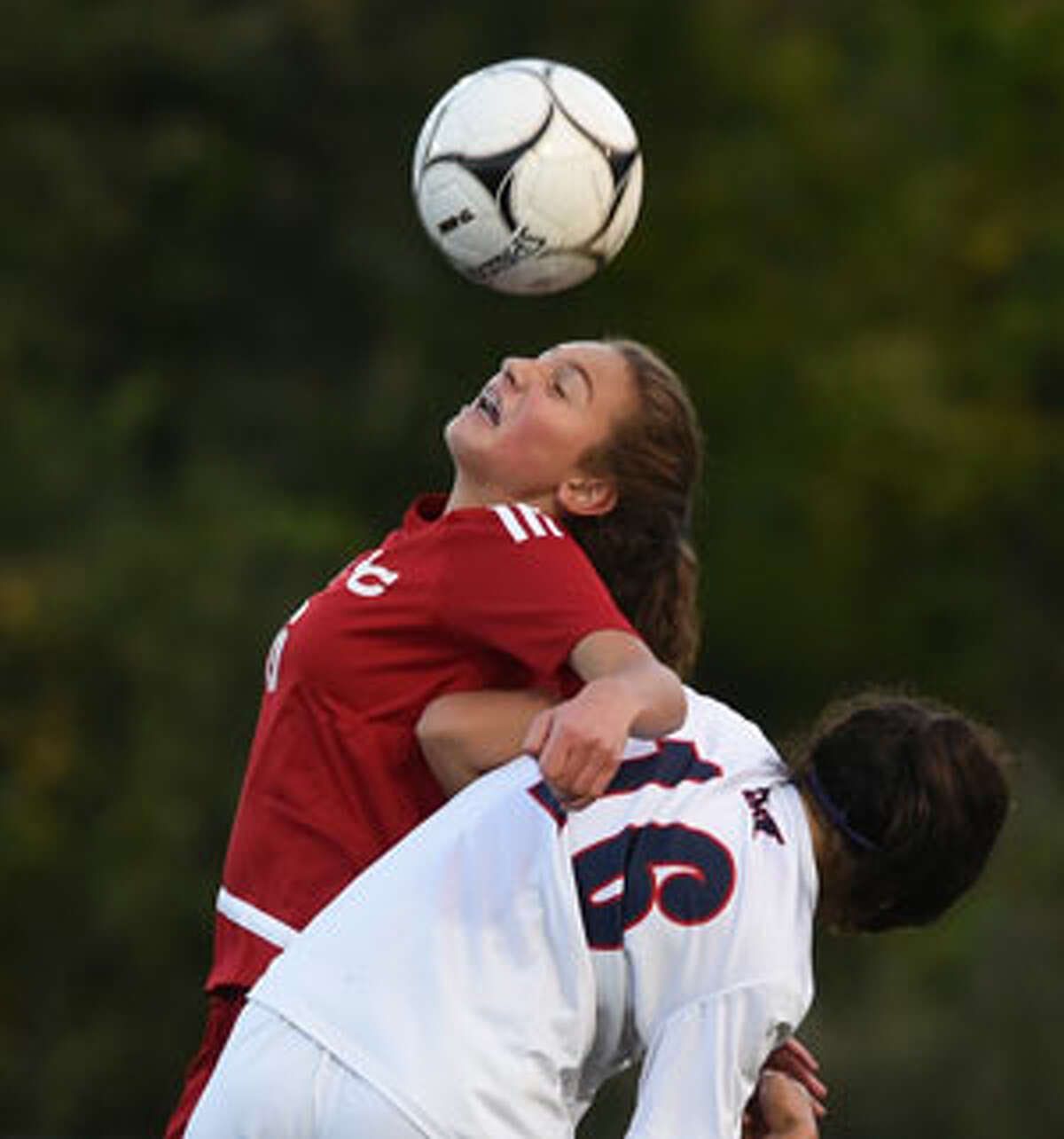 New Canaan freshman Kaleigh Harden goes high for the ball. - Dave Stewart photo