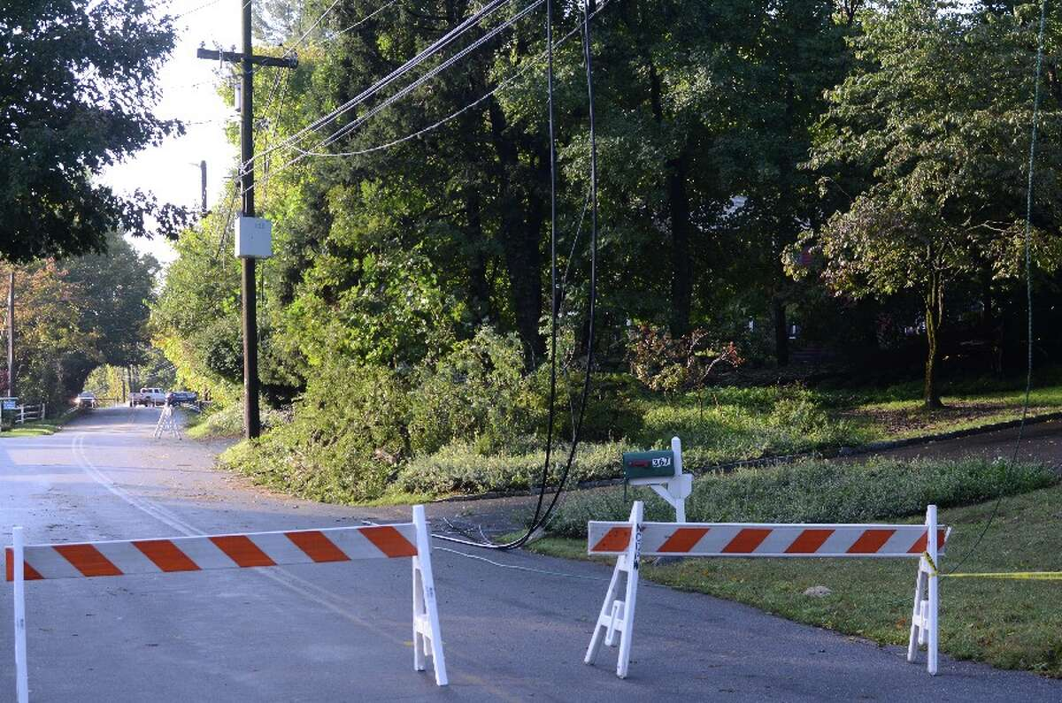 White Oak Shade Road was blocked Wednesday morning around 8:30 with wires hanging to ground. This view is looking south toward Merritt Pkwy overpass. - Greg Reilly photo