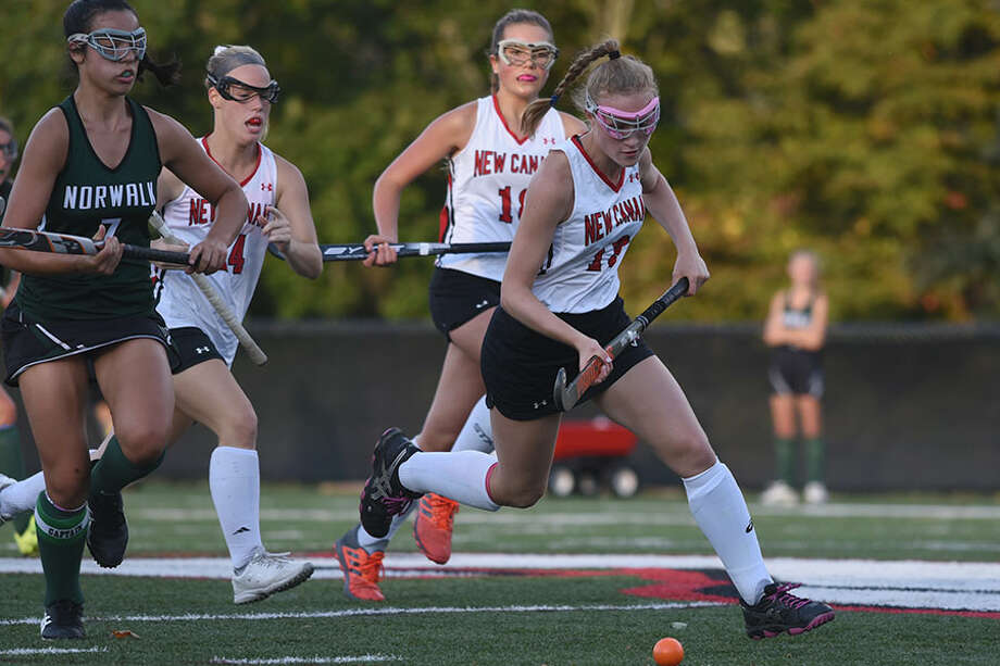 New Canaan's Zoey Bennett plays the ball in the midfield during the Rams' game with Norwalk Wednesday at Dunning Field.— Dave Stewart photo