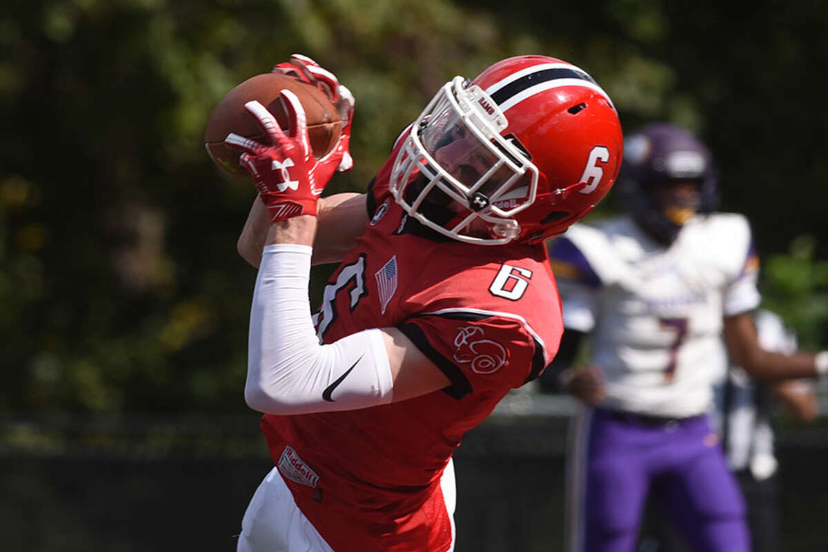 New Canaan's Wyatt Wilson catches a 6-yard touchdown pass from QB Drew Pyne for the Rams' first points in Saturday's 38-14 Homecoming win against Westhill. - Dave Stewart photo