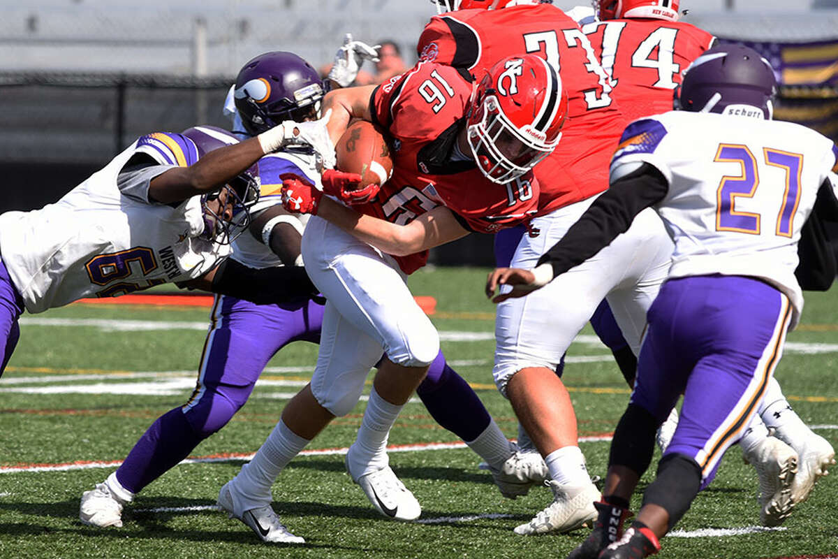 New Canaan's Christian Sweeney pounds out some yards en route to a touchdown in the Rams' Homecoming win over Westhill on Saturday, Sept. 29. - Dave Stewart photo