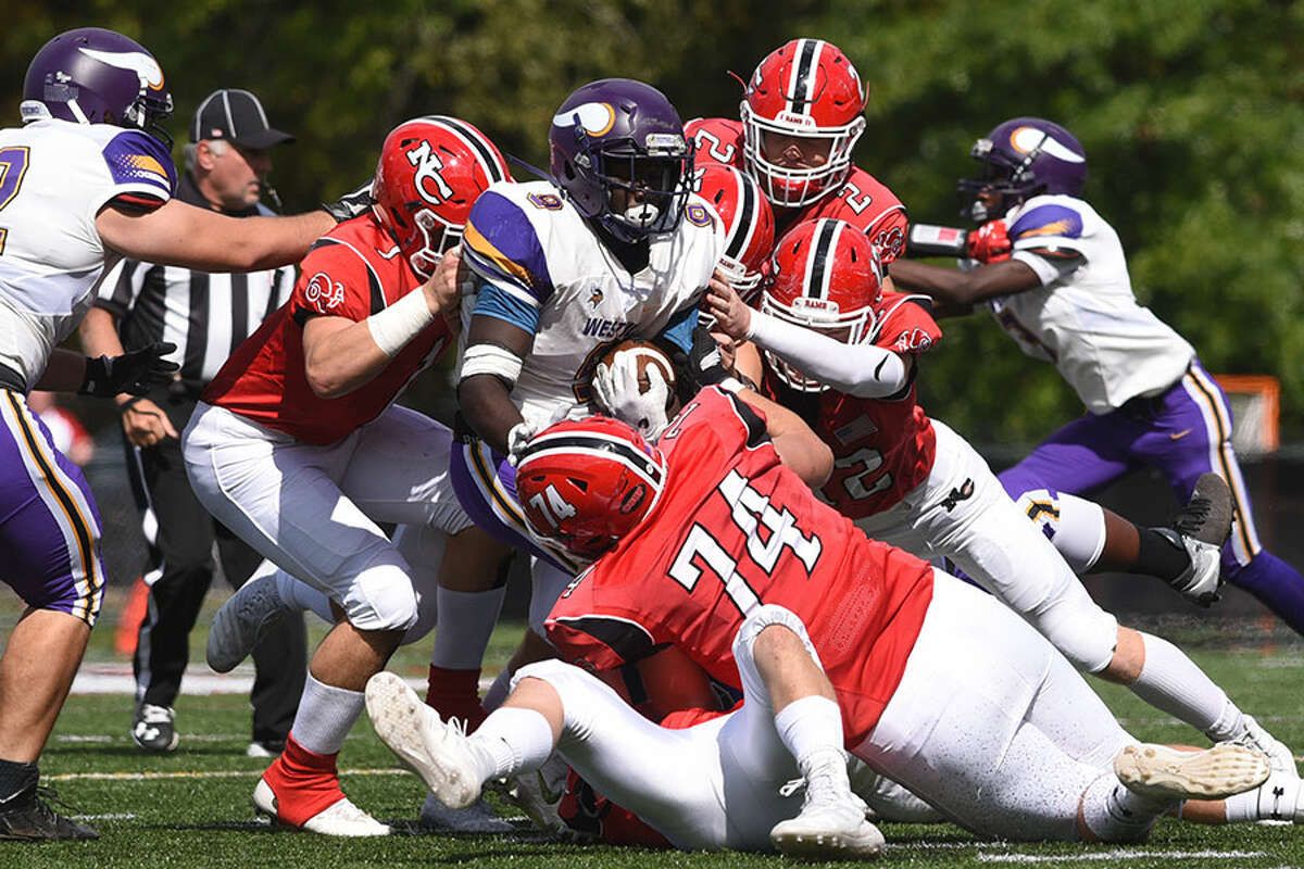 The Rams' defense wraps up a Westhill ball-carrier. - Dave Stewart photo