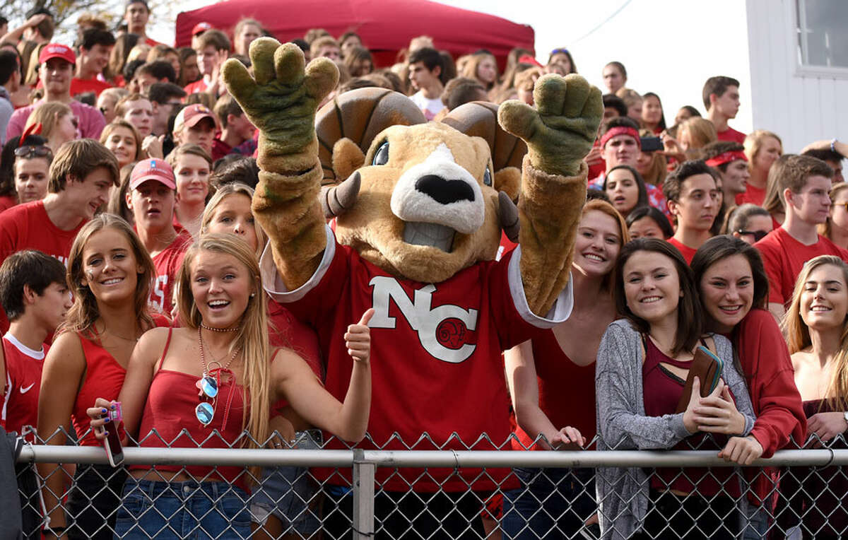 Randy the Ram celebrates with the crowd during last year's Homecoming football game at Dunning Field. The stands are sure to be packed when New Canaan hosts Westhill in this year's big game at 1:30 p.m., Saturday. - Dave Stewart photo