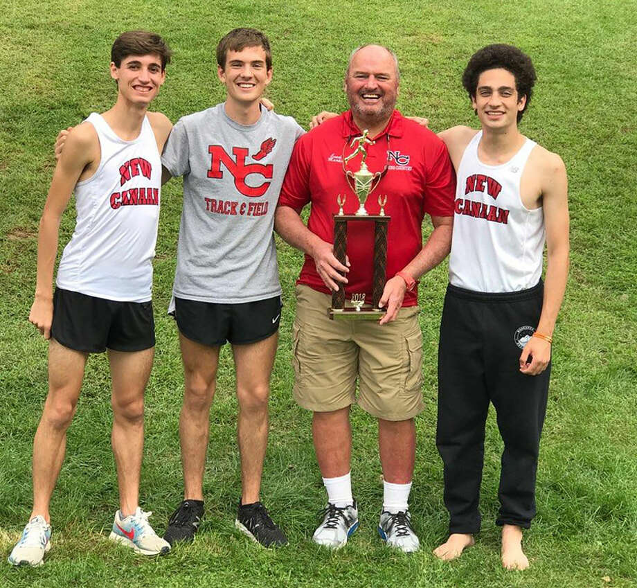 New Canaan's captains and coach display their trophy after the Rams won the Winding Trails Invitational Saturday in Farmington. From left are co-captains Cem Geray and Andrew Malling, head coach Bill Martin, and co-captain Alex Rashad.