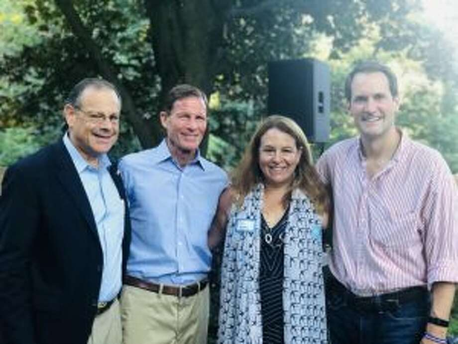 Lucy Dathan, a Democrat who is running to represent New Canaan in the Connecticut General Assembly's 142nd district, told the audience at the DTC barbecue on Sunday that social issues are important as well as financial issues. From left at DTC Barbecue, Ross Tartell, candidate for representative for 125 House District; U.S. Senator Richard Blumenthal, Candidate for 142 House District Lucy Dathan, and U.S. Congressman Jim Himes. — Contributed photo