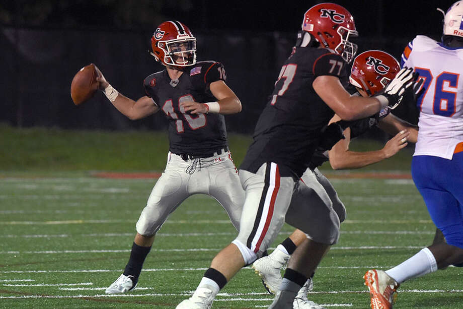 New Canaan junior QB Drew Pyne lines up for a pass during last Friday's football game at Dunning Field. — Dave Stewart photo