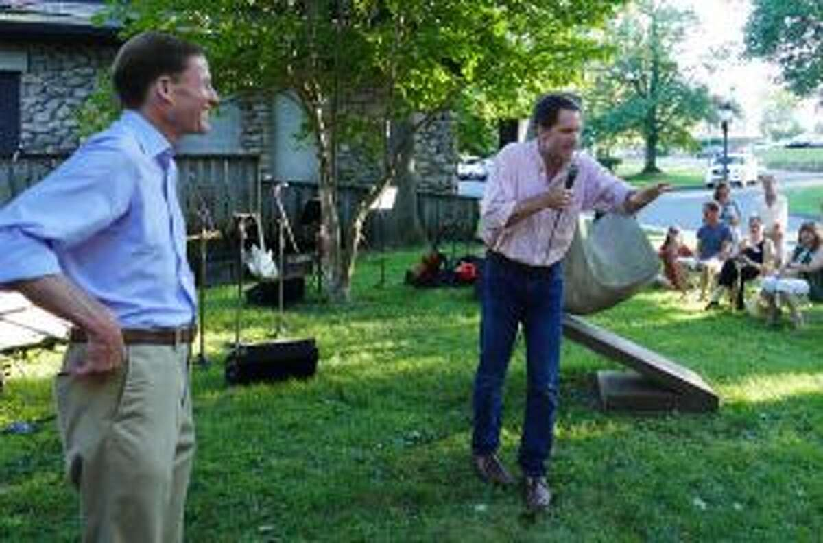 Congressman Jim Himes speaks enthusiastically to a crowd of 300 with Senator Richard Blumenthal looking on. - Grace Duffield photo