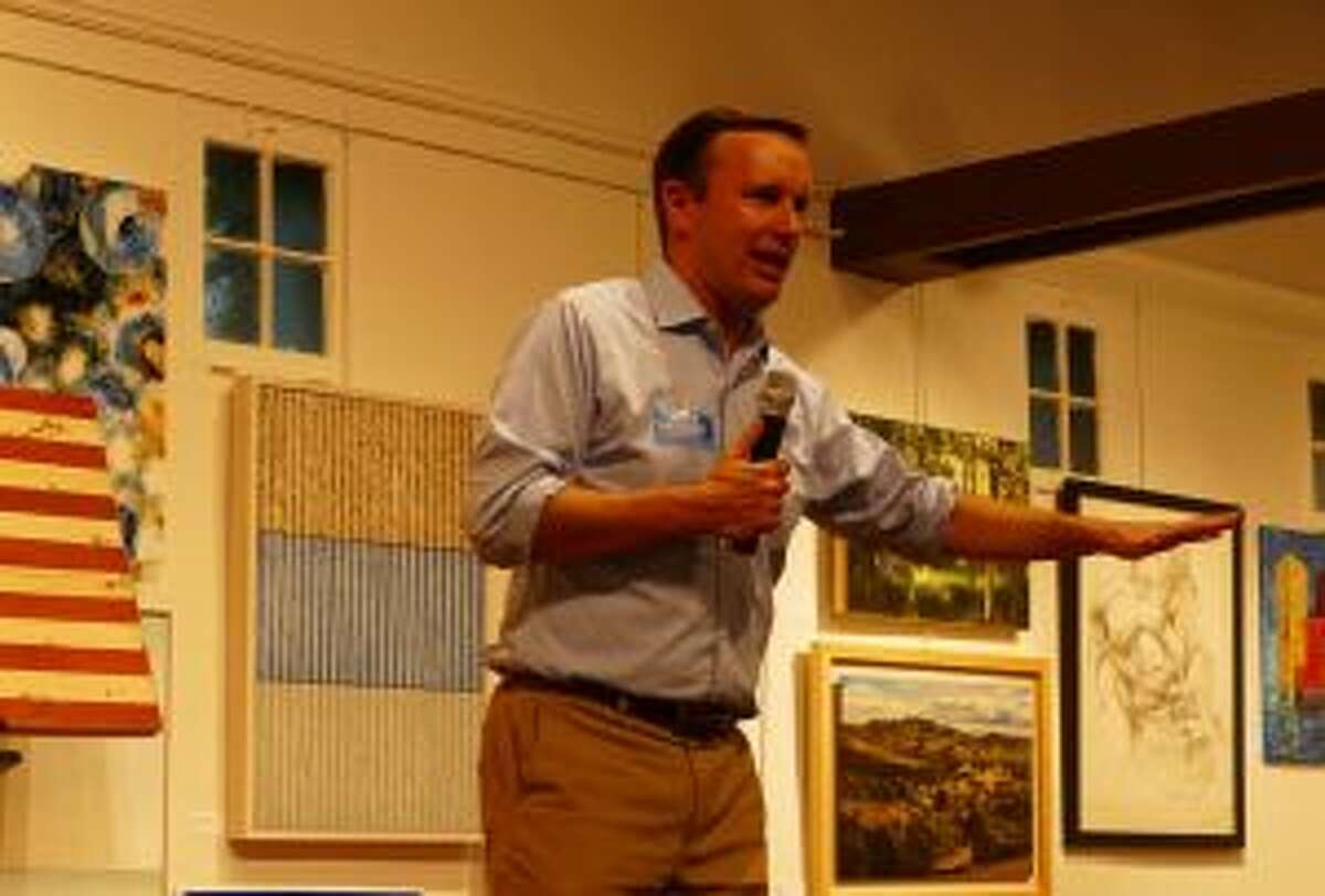 Chris Murphy talks to democrats in the Carriage Barn. - Grace Duffield photo