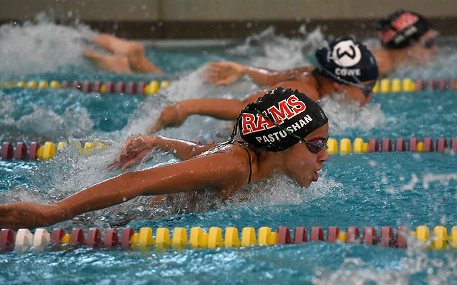New Canaan's Alex Pastushan competes in the butterfly. — Dave Stewart photo