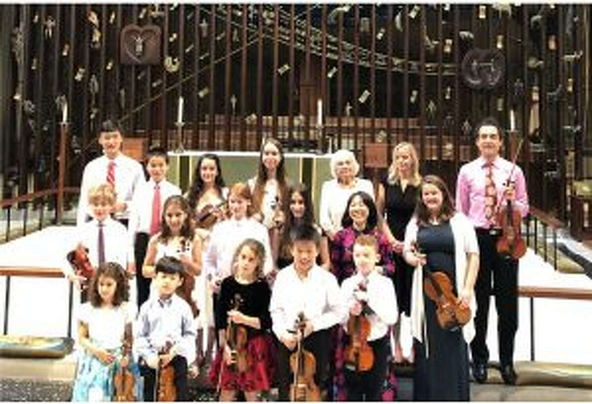 An international violinist, and a viola performer played in a Father's Day recital at St. Mark's Church in New Canaan.