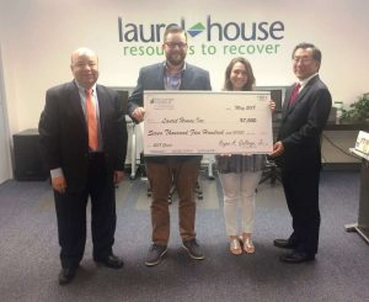 The First County Bank Foundation recently presented a $7,500 grant to the Laurel House to help fund its Tele-Education Support Program. First County Bank representatives Camilo Duque, Jr., assistant vice president, left, and Michael Yao, vice president-senior commercial banking officer, right, present a check to Michael Marsico, Supported Employment & education manager and Kelly Dougherty, Supported Education counselor. - Contributed photo