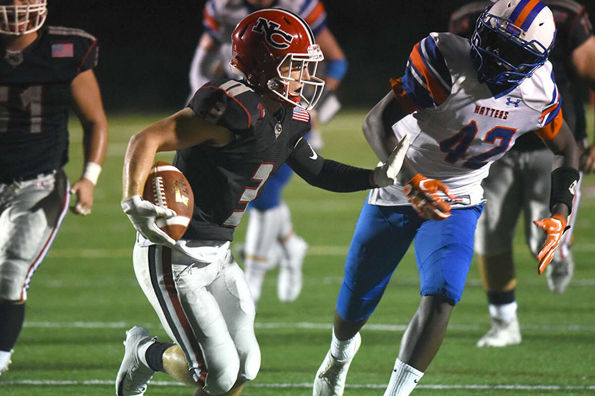 New Canaan's Luke Morton adds some yards after a catch during the Rams' 42-6 win over Danbury at Dunning Field. - Dave Stewart photo