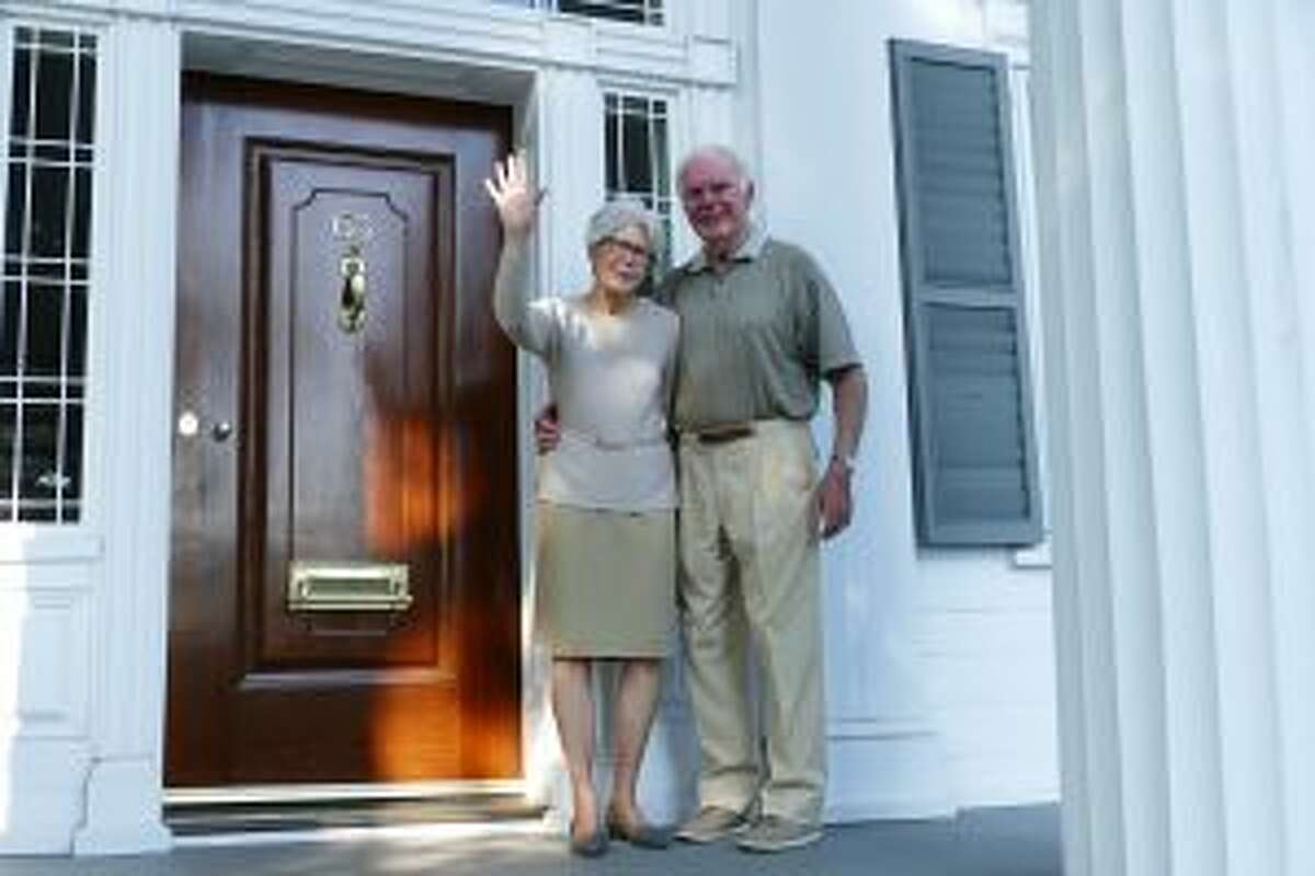 A town landmark has changed hands as its former owner's, the Bermanns head south. Sandra and Richard Bergmann on the porch of their home at 63 Park Street on Sept. 6. They bid a fond farewell after being part of New Canaan life for 45 years. - Greg Reilly photo