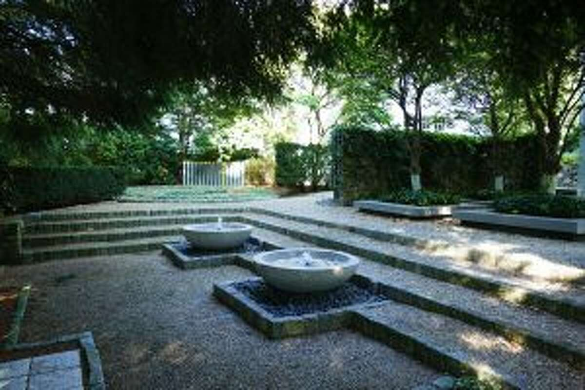 The Bergmanns created a unique series of outdoor garden rooms -