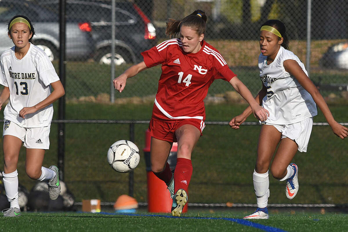 New Canaan's Kendall Patten, shown in action during the state tournament last fall, returns as a senior co-captain this year, alongside Katelyn Sparks and Caroline Schuh. - Dave Stewart photo