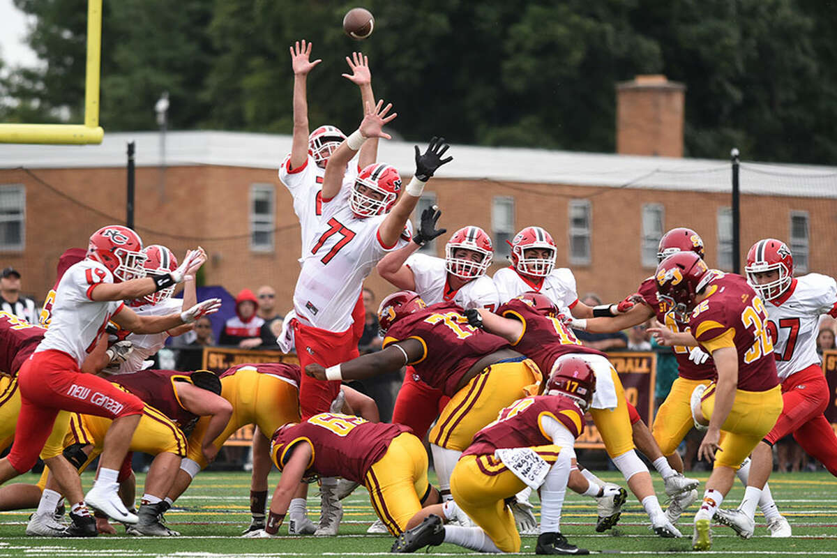 The New Canaan Rams attempt to clock a field goal attempt by St. Joseph's Luke Kirby during the season-opening football game at SJHS on Saturday, Sept. 8. - Dave Stewart photo