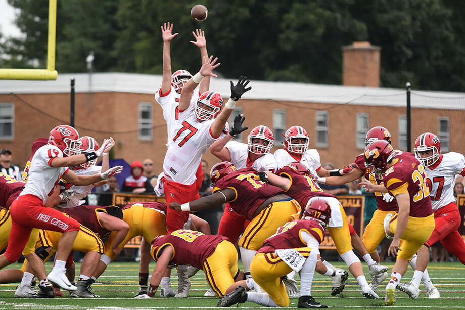 The New Canaan Rams attempt to clock a field goal attempt by St. Joseph's Luke Kirby during the season-opening football game at SJHS on Saturday, Sept. 8. — Dave Stewart photo