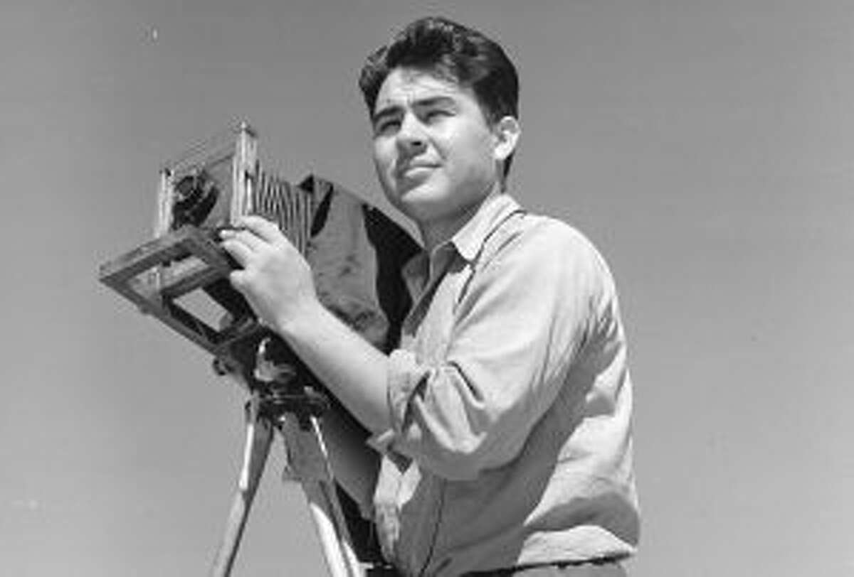 Photo of Pedro Guerrero with camera, 1938. - Copyright Pedro E. Guerrero Archives