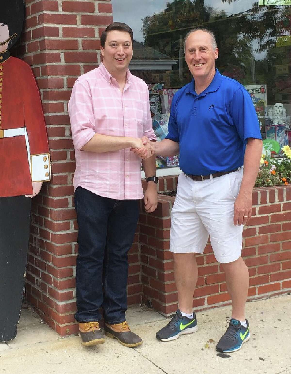 New owner of New Canaan Toy Store Nathan Shapiro, left, shakes hands with former owner Chris Kilbane outside the Park Street store a few days after the store changed hands. - Greg Reilly photo