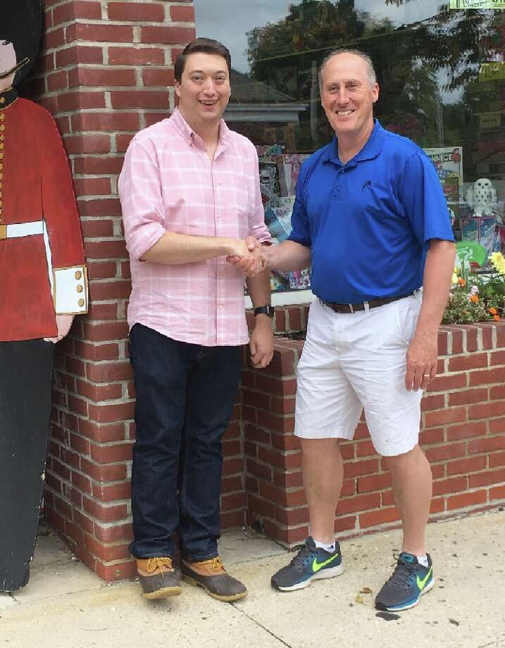 New owner of New Canaan Toy Store Nathan Shapiro, left, shakes hands with former owner Chris Kilbane outside the Park Street store a few days after the store changed hands. — Greg Reilly photo