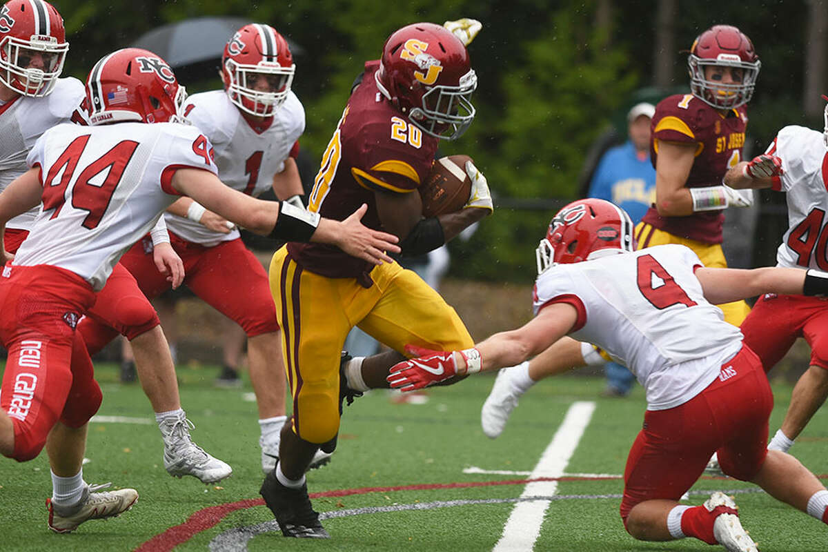 New Canaan's Christian Sibbett (44) and Drew Guida (4) close in on St. Joseph's Jaden Shirden during Sunday's football game at SJHS. - Dave Stewart photo