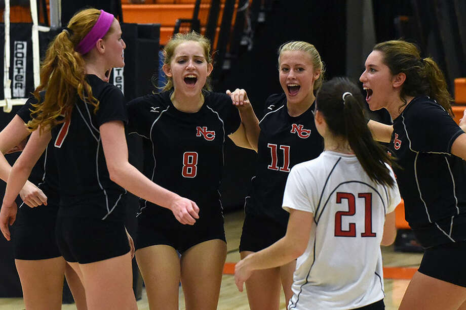 The Rams, including Josie Matyzewski (8) and Emma Wheeler (11) celebrate a point during their 2017 campaign. — Dave Stewart photo