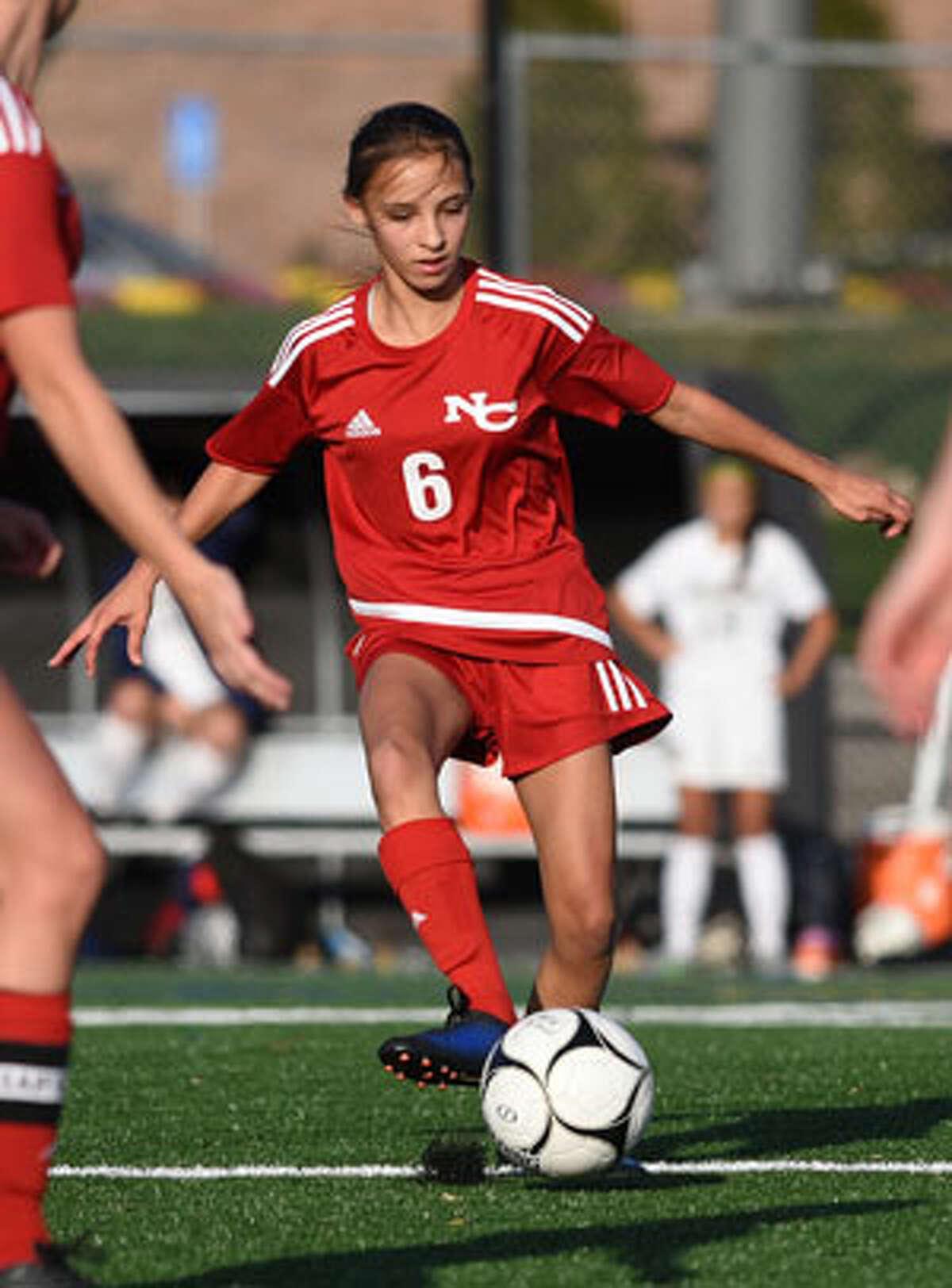 Sophie Potter, a junior, returns on the midfield line. - Dave Stewart photo