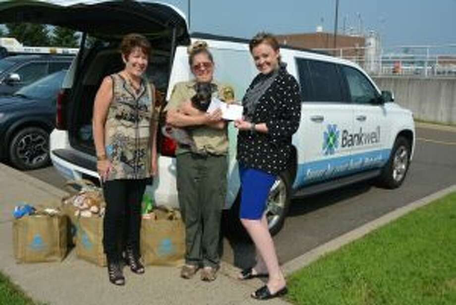 New Canaan: Bankwell has given to local animal shelters. New Canaan: Bankwell has given to local animal shelters. Katina Wargo, animal control officer at Stamford Animal Control & Care Center is shown with Bankwell's Lynne Gomez, left, and  Lucy French. — Contributed photo