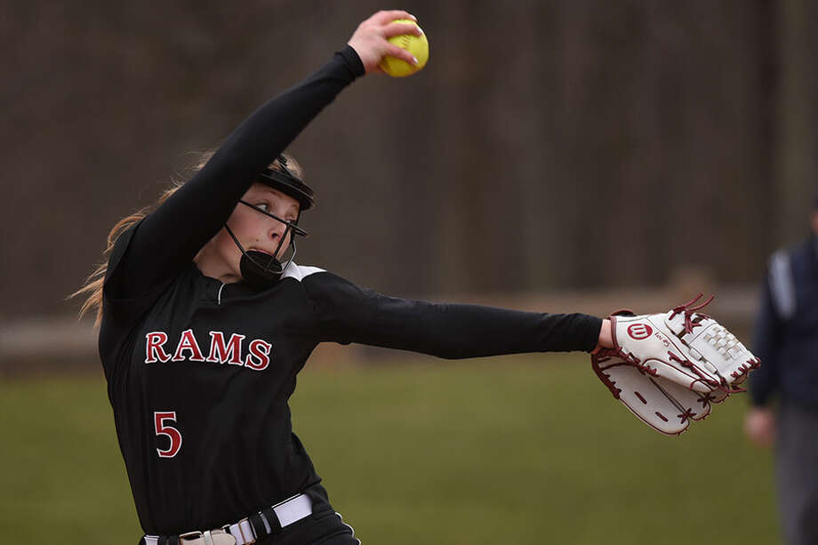 New Canaan's Gillian Kane in the windup during a game at Waveny Park last spring. Kane, who set Ram records for career wins (31) and strikeouts (569), will take her game to Springfield College starting this year. — Dave Stewart photo