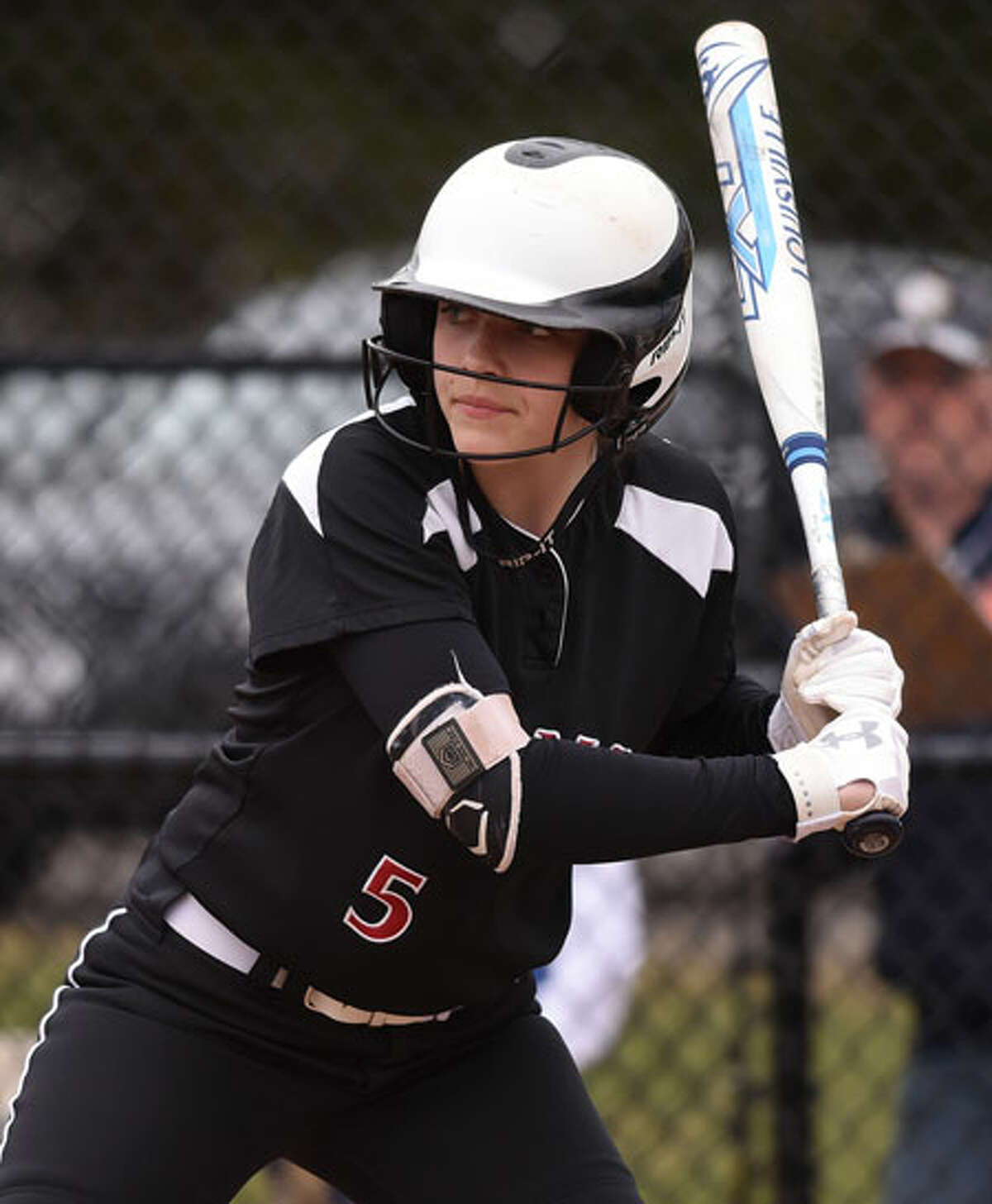 Gillian Kane awaits a pitch during a softball game in Waveny Park in the spring. - Dave Stewart photo