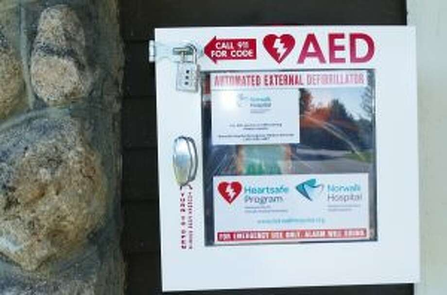 An AED at Irwin Park has a small lock on it with instructions to call 911 to get the combination in order to use. — Grace Duffield photo