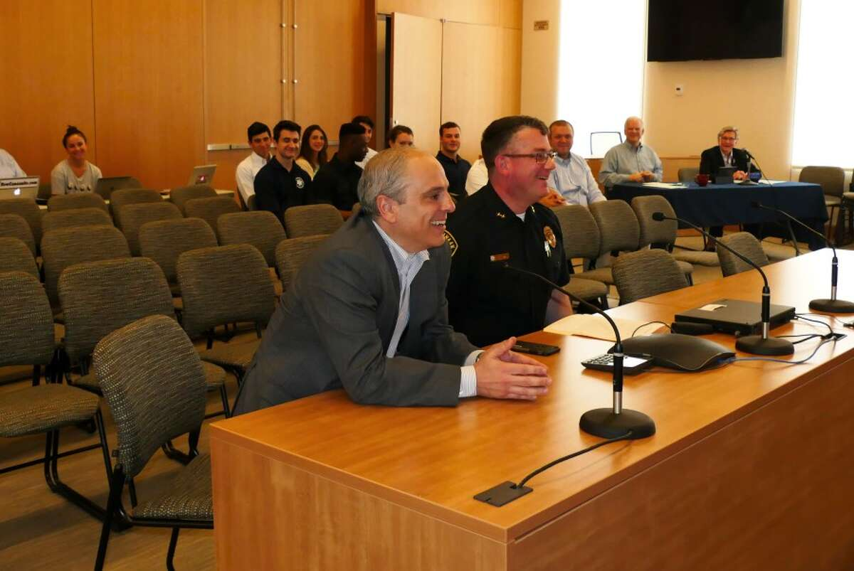 John Santopietro, M.D., with New Canaan Police Chief Leon Krolikowski at a Board of Selectmen meeting in May. -Grace Duffield photo