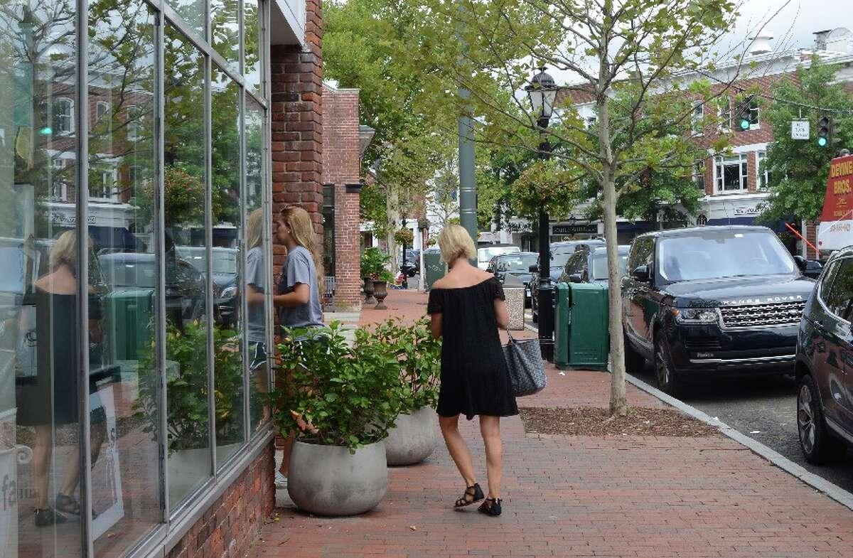 Mom follows daughter into a shop on Main. - Sarah Klearman photo