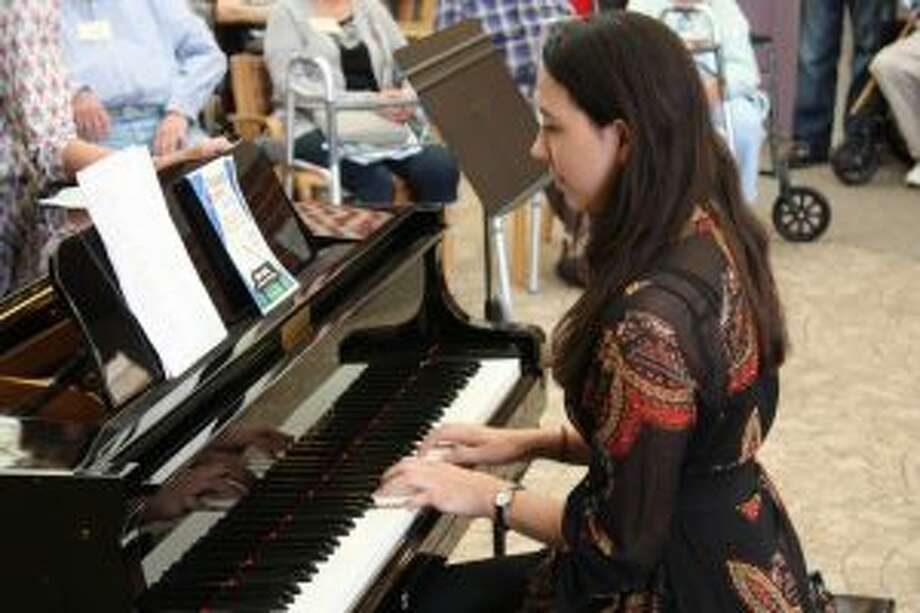 "The Waveny LifeCare Network in New Canaan brings local talent to ""Main Street."" Caroline Lui plays an original score at the recent Summer Showcase at Waveny LifeCare Network. — Contributed photo"