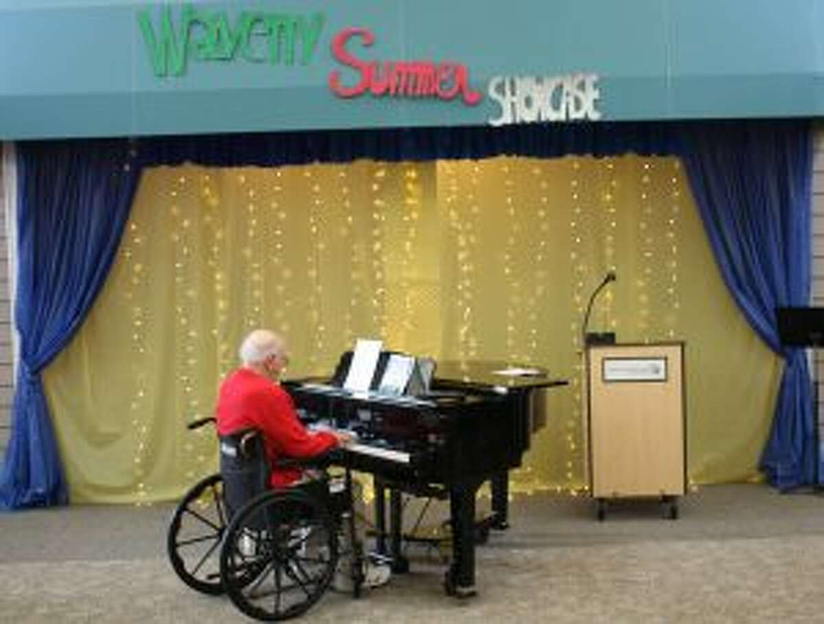 Dr. Charles Crown plays piano at the recent show. - Contributed photo