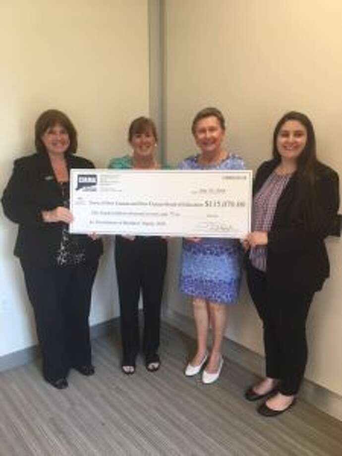 An insurer has delivered $115,000 to Town executives in New Canaan. From left, Colleen White, senior underwriter; Cheryl Jones, Town of New Canaan Human Resources director; Sandra Dennies, Town of New Canaan CFO and Mallory Monaco, underwriter trainee. — Contributed Photo