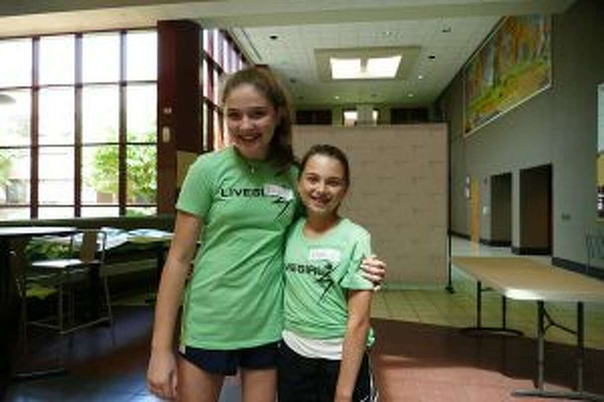 Campers shared their voices at a recent Camp LiveGirl event at New Canaan High School. Ella Dempster of Wilton, left and Izzy Gaumer of New Canaan at Camp LiveGirl last week. Down below: Gaumer channeled camp spirit by sporting Rosie the Riveter mid-calves. - Sarah Klearman photos