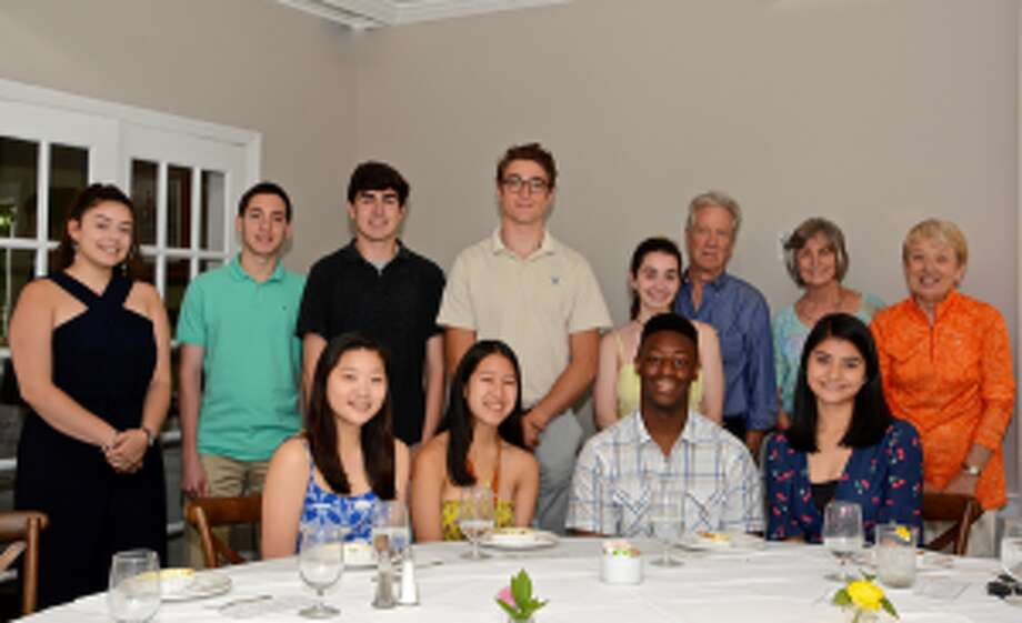 The Kiwanis Club of New Canaan awarded nine scholarships to local youth at its recent luncheon. Some of the New Canaan High School students that won scholarships are shown attending the luncheon. Standing, from left, Isabella Rocha, Derek Perone, Diego Ospina, Logan Otis, Regan O'Malley; along with Jerry Miller, chairman of the scholarship committee and Joan Guzzetti and Eloise Killeffer, members of the scholarship committee; seated, from left, Ayla Senna, Julianna Leung, Josiah Jones, and Isabella Montano. — Contributed photo