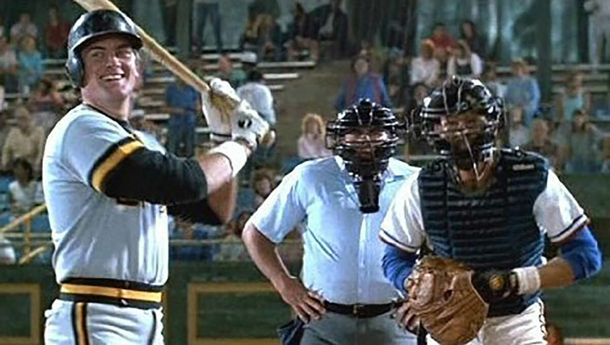 New Canaan native Paul Devlin at the plate with Kevin Costner as catcher Crash Davis during the movie Bull Durham, which was released 30 years ago in 1988.