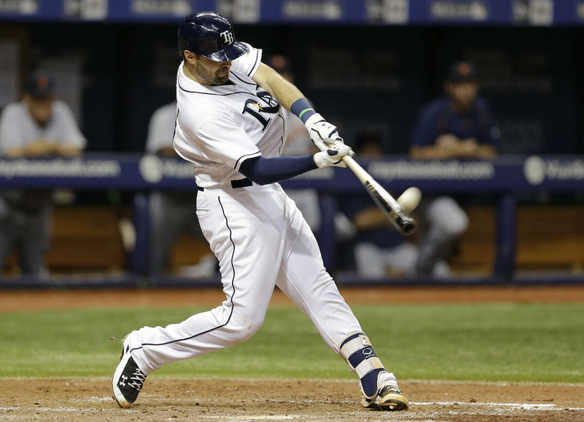 Tampa Bay Rays' Curt Casali connects for a two-run home run off Detroit Tigers relief pitcher Bruce Rondon in a MLB game in 2015. - AP Images/Chris O'Meara photo