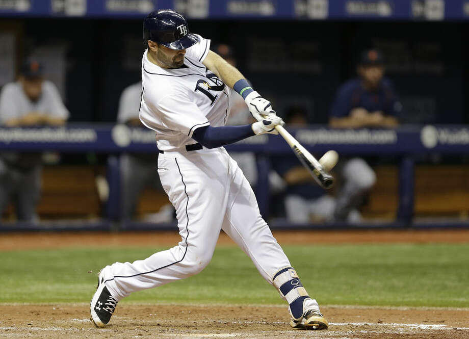 Tampa Bay Rays' Curt Casali connects for a two-run home run off Detroit Tigers relief pitcher Bruce Rondon in a MLB game in 2015. — AP Images/Chris O'Meara photo