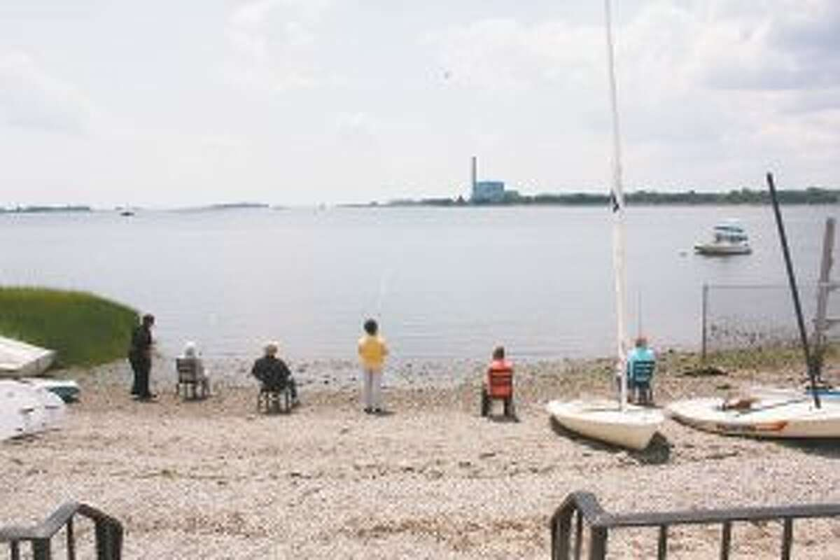Waveny residents recently went fishing at a beach in Norwalk, Conn. Waveny residents and Adult Day Program participants fish at Calf Pasture Beach. - Contributed photo