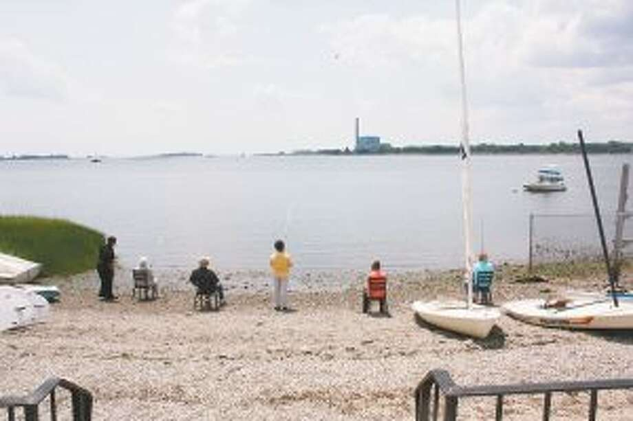 Waveny residents recently went fishing at a beach in Norwalk, Conn. Waveny residents and Adult Day Program participants fish at Calf Pasture Beach. — Contributed photo