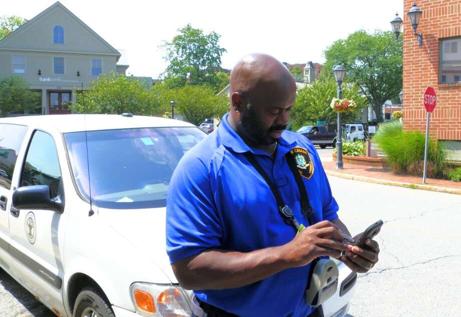 Mike McCargo, known as Mr. Mike, demonstrated filling out a ticket. He has worked for the Parking Department for seven years. — Grace Duffield photo