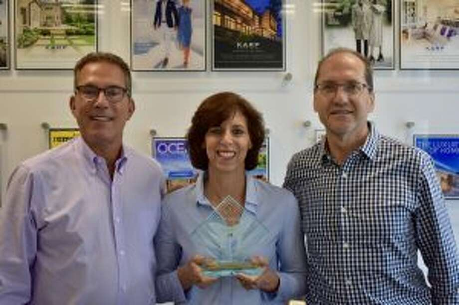 New Canaan: Karp Associates has won a remodeling award. Pictured along with Robin Carroll, lead project manager and interior designer are Arnold Karp, left, founder and president, and Paul Stone, chief operating officer of Karp Associates. — Contributed photo
